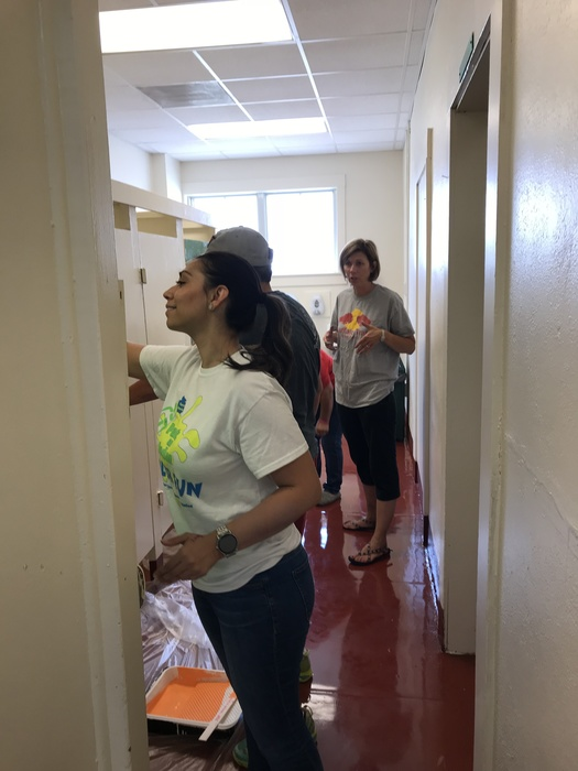 Ms. Sanchez, Ms. Welch, Ms. Merrill and Ms. Aguilar paint the boys restroom