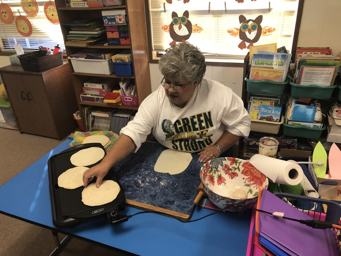 Mrs. Olivas demonstrates how to make tortillas